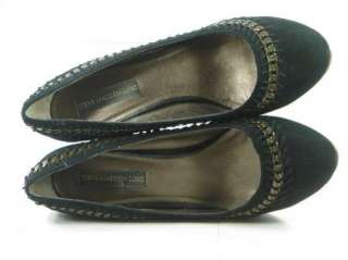 Black Suede uppers accented with brass cable chain detailing held