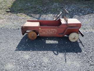 HERE IS A VINTAGE PEDAL CAR MADE BY HAMILTON. IT IS A JEEP FIRE TRUCK