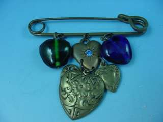 This is a fabulous vintage heart motif charm necklace from Glass Works